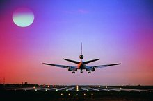 airplane_taking_off_at_sunset