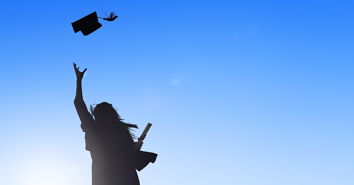 woman_throwing_graduation_cap_into_sky