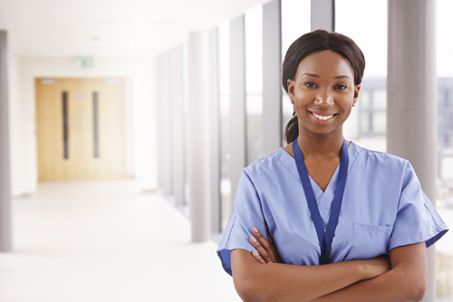 nurse_with_arms_crossed_standing_in_hallway