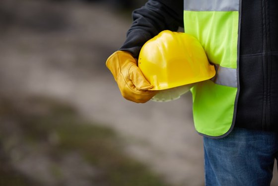 construction_worker_holding_hard_hat